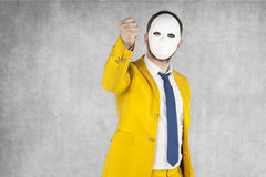 Someone threatens fist, mask on the face. Businessman stock photos