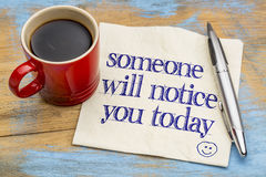 Someone will notice you today. Positive affirmation concept - handwriting on a napkin with a cup of coffee Stock Photos