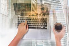 Someones hands and latop. Someones hands holding cofee and typing on laptop on white desktop, top view workspace, double exposure with modern cityscape Stock Photos
