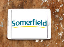 Somerfield  stores logo. Logo of the international chain of convenience stores somerfield on samsung tablet on wooden background Stock Photography