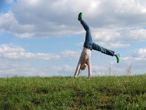 Somersault. On grass on the sky&clouds background Stock Images