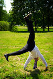 Somersault. Businessman doing cartwheel in the park Royalty Free Stock Image