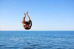 Somersault Above Sea Stock Photo