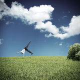 Somersault on the Grass. Somersault of Teenage Boy in the Summer Field Stock Photography