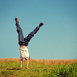 Somersault on the Grass Royalty Free Stock Photo