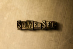 SOMERSET - close-up vintage sujo da palavra typeset no contexto do metal Imagens de Stock Royalty Free