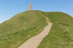 Somerset Glastonbury Tor Hill England UK. Glastonbury Tor Somerset England, which features the roofless St. Michael's Tower. It is a Scheduled Ancient Monument Royalty Free Stock Image