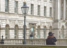 Somerset house, london, england uk. Somerset house exterior with stone cladd columns and victorian lamp post in London, england royalty free stock photo