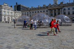 Climate change Pinksy pollution pods. SOMERSET HOUSE, LONDON, UK - APRIL 22nd 2018: Pinksy Pollution Pod exhibit in the centre of the square inside Somerset royalty free stock photos