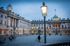 Somerset House London. View of the grand buildings and courtyard at dusk in Central London royalty free stock photos