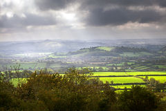 Somerset Levels View. View of the Somerset Levels and Glastonbury Tor in the mist with a dramatic sky Royalty Free Stock Images