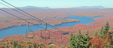 Somerset Reservoir. Wilmington Vermont and chair lift from Mount Snow Ski Resort Vermont summit in Fall colors and Green Mountains forest Royalty Free Stock Photography