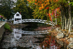 Somesville bridge with reflections in water. SOMESVILLE- OCTOBER 12 : From Village of Somesville is this most photographed bridge and museum building with early stock image