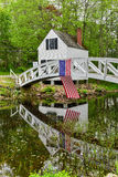 Somesville, Mount Desert Island Footbridge. Footbridge in Somesville, Mount Desert Island in Maine with the USA Flag reflecting in the pond Royalty Free Stock Photos