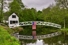 Somesville, Mount Desert Island Footbridge. Footbridge in Somesville, Mount Desert Island in Maine with the USA Flag reflecting in the pond Stock Photography