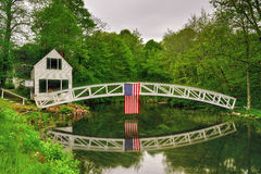 Somesville, Mount Desert Island Footbridge. Footbridge in Somesville, Mount Desert Island in Maine with the USA Flag reflecting in the pond Stock Images