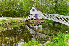 Somesville, Mount Desert Island Footbridge. Footbridge in Somesville, Mount Desert Island in Maine with the USA Flag reflecting in the pond Royalty Free Stock Photography