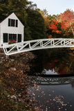 Somesville wooden bridge with reflections in water. SOMESVILLE- OCTOBER 12 : From Village of Somesville is this most photographed bridge and museum building with royalty free stock photos