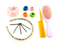 Something for beautiful hair. Hairbrushes, elastic bands, headband and hairpins for hair on a white background Royalty Free Stock Image