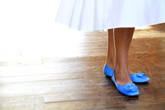 Something blue. Bride on the dance floor wearing her blue shoes as something blue Stock Photo
