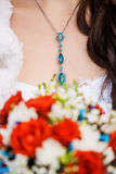Something blue. Close up of neck of young bride stock photography