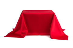 Something covered with red cloth. On a white background Stock Images