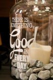 Something good in every day. A home decoration item, a jar with there is something good in every day motivational quote, candle and pebbles inside Royalty Free Stock Image