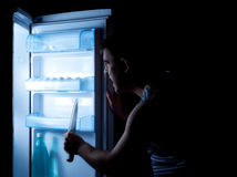 Something horrible hiding in refrigerator Stock Image