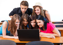 Something Interesting On Laptop. Students looking surprised at the laptop's screen Stock Photo