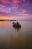 Something left behind. And evening were yellow and purple sunset at bech with isolate boat slow shutter Royalty Free Stock Photography