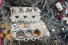 Something is Missing. This is an engine block in a stolen sports car that has been stripped of all useable parts stock photography