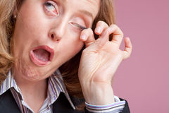 Something in my eye. Close-up of businesswoman rubbing her eye Stock Photos