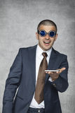 Something new. Business man and his new phone Stock Images