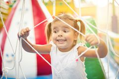 This is something new for me. Little happy girl spending time on playground. Close up. Space for copy royalty free stock photos