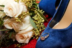 Bride`s Engagement Ring Resting on her Blue Suede Wedding Shoes. Something Old, Something New, Something Borrowed, Something Blue stock images