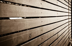 Something's behind that fence. Sepia style fence .Selective focus royalty free stock images