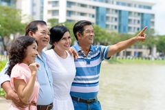 Something in the sky. Vietnamese men showing something in the sky to his senior friends Royalty Free Stock Photo