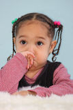 Something smells. Toddler covering her nose showing that something smells Stock Photography