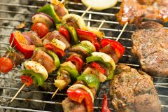 Something specia for real meat lovers. Shot of meat being prepared on a grill royalty free stock images