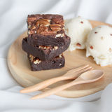 Something sweet. Enjoy walnut brownie and ice cream royalty free stock images