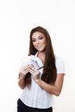 Something to buy. Young attractive woman holding a hand full of english back notes Stock Photo