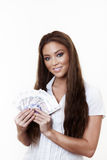 Something to buy. Young attractive woman holding a hand full of english back notes Royalty Free Stock Photos