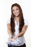 Something to buy. Young attractive woman holding a hand full of english back notes Royalty Free Stock Photography