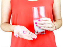 Something to ease the pain. Cropped view of a woman's hand holding some pills Royalty Free Stock Photos