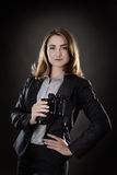 Something to find. Business woman holding binoculars shot in the studio on gray background Royalty Free Stock Photos
