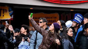 Something to remember. Girl taking pictures on New Year's Eve in Times Square, New York Royalty Free Stock Photos