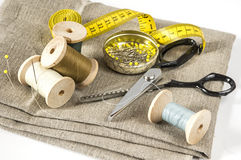 Something to sew. Some sewing utensils and fabric Royalty Free Stock Photos