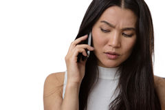 Something to think about. Business woman talking on a phone looking concerned and worried about the conversation royalty free stock photo