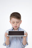 Something went wrong. Astonished child watching empty tablet screen Stock Image