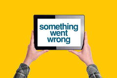Something Went Wrong Message on Digital Tablet Computer Display. Woman Holding Device, Isolated on Yellow Background royalty free stock photo
